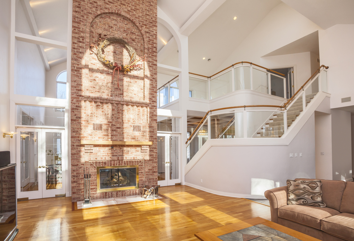 Amazing Home Interior Architecture, Cathedral Ceiling With Brick Fireplace  And Spectacular Glass Staircase.